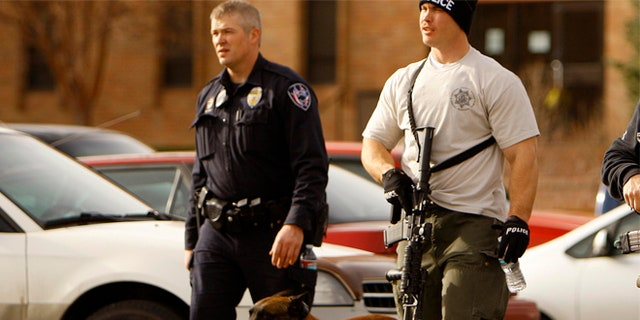 Nov. 30, 2012: Casper police leave the Wold Physical Science Building while investigating a murder and suicide at Casper College, Friday Nov. 30, 2012, in Casper, Wyo.