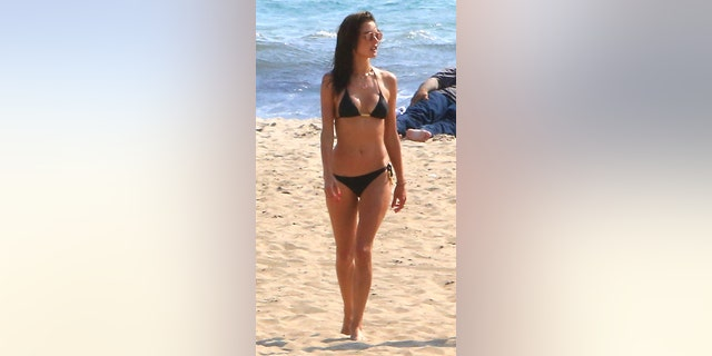 "Alessandra Ambrosio got some sand between her toes, making time for a trip out to the beach in Malibu. The Victoria's Secret supermodel donned a black bikini, absorbing as much sunlight as possible. <a data-cke-saved-href=""https://www.x17online.com/2016/06/alessandra_ambrosio_blonde_wig_joke_photos_061716"" href=""https://www.x17online.com/2016/06/alessandra_ambrosio_blonde_wig_joke_photos_061716"" target=""_blank"">MORE: THANK GOD ALESSANDRA AMBROSIO DIDN'T GO BLONDE</a>"