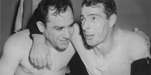 Yogi Berra and Joe DiMaggio of the New York Yankees celebrate winning the 1950 World Series against the Philadelphia Phillies. (Photo by Sporting News/Sporting News via Getty Images)