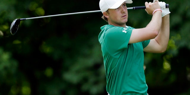 July 14, 2013: Jordan Spieth hits off the 17th green during the final round of the John Deere Classic golf tournament.