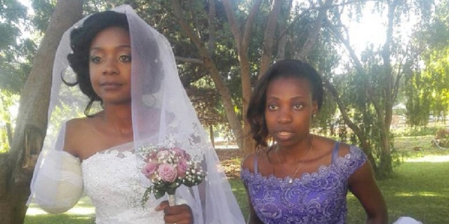 Zanele Ndlovu walked down the aisle wearing a one-shoulder white dress.