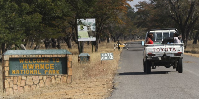 August 2, 2015 - Visitors arrive at Zimbabwe's Hwange National Park. After the killing of Zimbabwe's best known lion, a second animal has been poached by a foreigner, a source said on Saturday as authorities banned big game hunting outside the park from which Cecil was lured to his death.