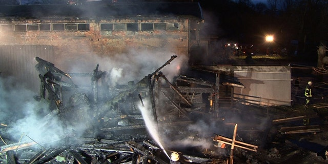 Nov. 13: Firefighters work to extinguish a fire at the Karlsruhe Zoo, in which 26 animals perished.