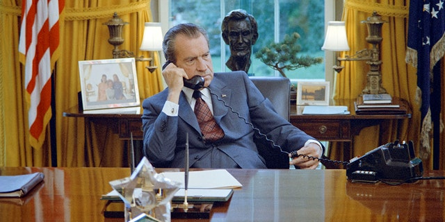 U.S. President Richard Nixon seated at his desk in the White House Oval Office in Washington, U.S.,  June 1972.