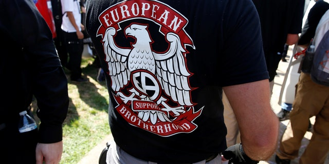 """File photo - A white supremacist wears a shirt with the slogan """"European Brotherhood"""" at a rally in Charlottesville, Virginia, U.S., Aug. 12, 2017. (REUTERS/Joshua Roberts)"""