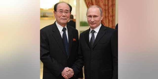 Russian President Vladmir Putin with the president of the Presidium of North Korea's Supreme People's Assembly Kim Yong Nam.