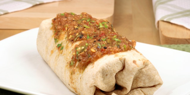 delicious mexican famous burrito with hot sauce