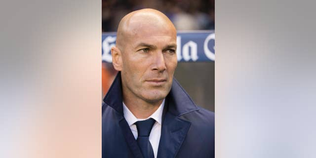 Real Madrid's coach Zinedine Zidane during a Spanish La Liga soccer match between Deportivo La Coruna and Real Madrid at the Riazor stadium in A Coruna, Spain, Wednesday April 26, 2017. (AP Photo/Lalo R. Villar)