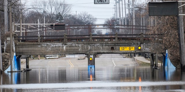 Pennsylvania Avenue at the Potter Park Zoo entrance is still closed due to flooding, Saturday, Feb. 24, 2018 in Lansing, Mich.