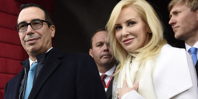 FILE: Treasury Secretary Steven Mnuchin and his wife, Louise Linton in Washington