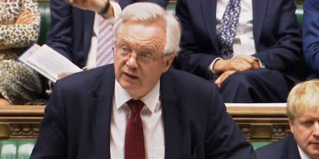 Britain's Brexit Secretary David Davis speaks in the House of Commons, London during the second reading debate on the EU (Notification on Withdrawal) Bill, Tuesday, Jan. 31, 2017. British lawmakers are starting debate on a bill authorizing the start of European Union exit talks, as the government races to meet a self-imposed March 31 deadline to begin the process. (PA via AP)