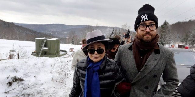 Yoko Ono, left, and her son Sean Lennon visit a fracking site in Franklin Forks, Pa., during a bus tour of natural-gas drilling sites in northeastern Pennsylvania, Jan. 17, 2013. (Associated Press).