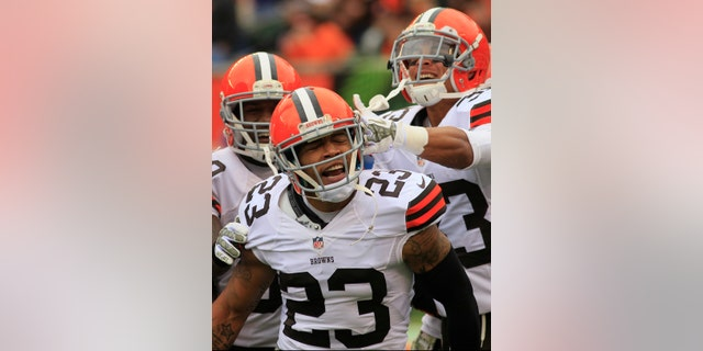 FILE - In this Nov. 17, 2013 file photo, Cleveland Browns cornerback Joe Haden (23) celebrates after scoring a touchdown on an interception in the first half of an NFL football game against the Cincinnati Bengals in Cincinnati. Haden, playing the best football of his life, credits his growth as a player to his four-game suspension last season and his maturity to getting married earlier this year. (AP Photo/Tom Uhlman)