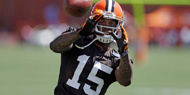 FILE - In this July 25, 2013, file phot, Cleveland Browns wide receiver Davone Bess catches a pss during NFL football  training camp at the team's training facility in Berea, Ohio. The Browns say they are aware of potentially incriminating photos posted by wide receiver Davone Bess on his Twitter account. Bess, who missed Cleveland's final two games for personal reasons, posted a photo on Thursday, Jan. 16, 2014, of a small package containing what appears to be marijuana. (AP Photo/Mark Duncan)