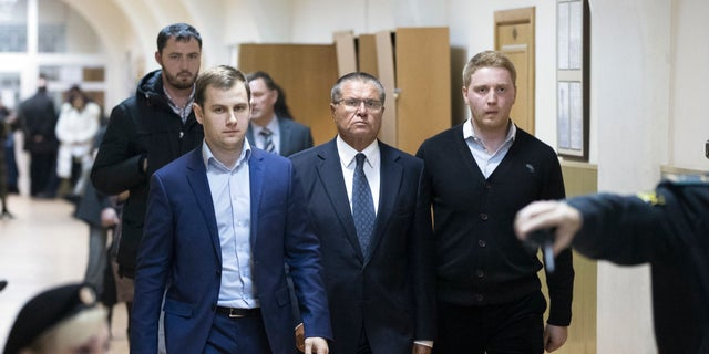 Russian Economic Development minister Alexei Ulyukayev, center, escorted to a court room in Moscow on Tuesday.