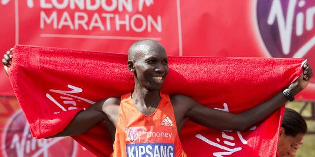 Wilson Kipsang of Kenya crosses the finish line to win the men's 2012 London Marathon on April 22
