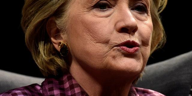 Former U.S. Secretary of State, Hillary Clinton speaks during an interview with Mariella Frostrup at the Cheltenham Literature Festival in Cheltenham, Britain Oct. 15, 2017. (REUTERS/Rebecca Naden)
