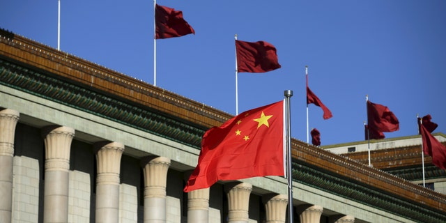 Chinese flag waves in front of the Great Hall of the People in Beijing, China, Oct. 29, 2015 - file.