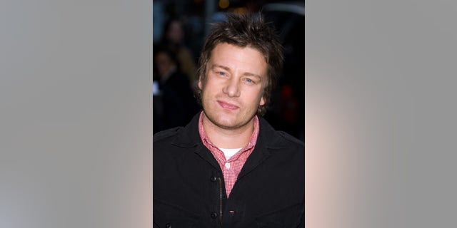 """File - Chef Jamie Oliver arrives for a taping of the """"Late Show with David Letterman,"""" in this Nov. 10, 2008 file photo taken in New York."""