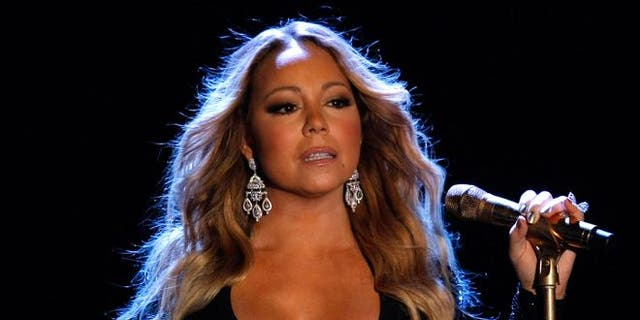 Mariah Carey performs on stage in 2014.