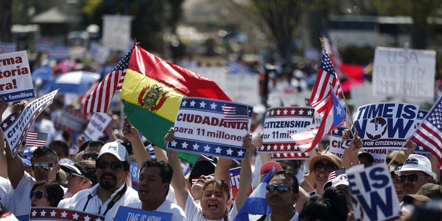 Activists participate in a rally for immigration reform on Capitol Hill in Washington, Wednesday, April 10, 2013, where tens of thousands of immigrants and their supporters are expected to rally for immigration reform. Bipartisan groups in the House and Senate are said to be completing immigration bills that include a pathway to citizenship for the nation's 11 million immigrants with illegal status.  (AP Photo/Charles Dharapak)