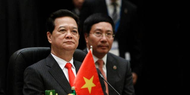 FILE - in this April 27, 2015 file photo, Vietnam's Prime Minister Nguyen Tan Dung waits for the plenary session of the 26th ASEAN Summit in Kuala Lumpur, Malaysia. Dung stepped down Wednesday, April 6, 2016, after 10 years in office, leaving behind a mixed legacy of promoting failed state enterprises but at the same time attracting foreign investment and daring to challenge China. (AP Photo/Joshua Paul, File)
