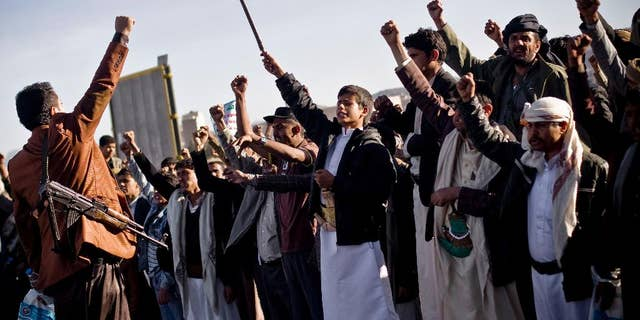 Houthi Shiite Yemenis chant slogans during a rally to show support for their comrades in Sanaa, Yemen, Wednesday, Jan. 28, 2015.  Rebels who control the Yemeni capital have beaten back dozens of people marching in protest against them, firing automatic rifles in the air and striking protesters with batons and knives. (AP Photo/Hani Mohammed)
