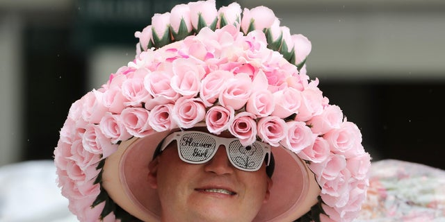 A patron wears a derby hat before the 2017 Kentucky Oaks at Churchill Downs.