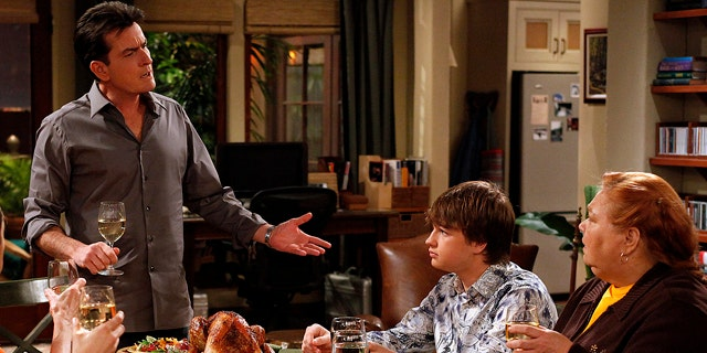 """Charlie Sheen, Angus T. Jones and Conchata Ferrell are shown during the taping of """"Two and a Half Men"""" in Los Angeles."""