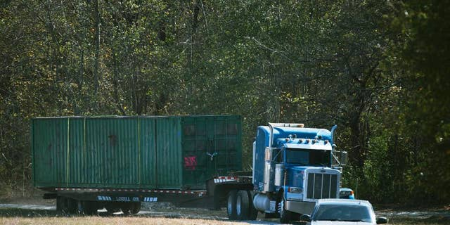 The shipping container in which an abducted woman was held for two months, being removed from Todd Kohlhepp's property in Woodruff, S.C., in 2016. (Lauren Petracca/The Greenville News via AP)