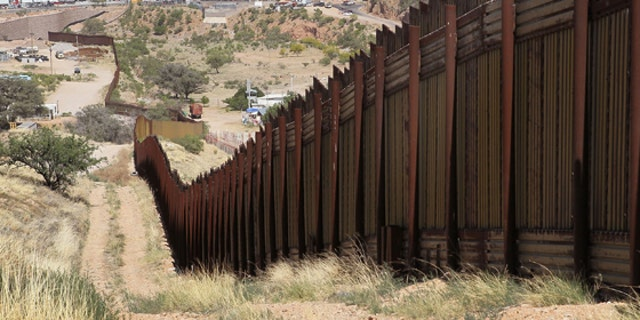 NOGALES, AZ - JUNE 02:  A fence separates the cities of Nogales, Arizona (L) and Nogales, Sonora Mexico, a frequent crossing point for people entering the United States illegally, June 2, 2010 in Nogales, Arizona.  During the 2009 fiscal year 540,865 undocumented immigrants were apprehended entering the United States illegally along the Mexican border, 241,000 of those were captured in the 262 mile stretch of the border known as the Tucson Sector.  (Photo by Scott Olson/Getty Images)
