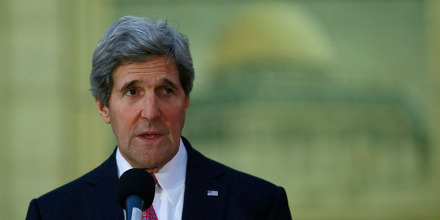 U.S. Secretary of State John Kerry speaks to the media after his meeting with Palestinian President Mahmoud Abbas in the West Bank city of Ramallah, Saturday, Jan. 4, 2014. Kerry is on his 10th visit to the region to try to craft a peace treaty that would create a Palestinian state alongside Israel. (AP Photo/Majdi Mohammed)