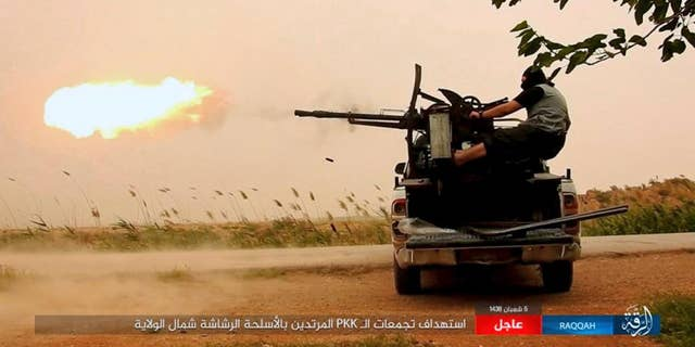 An ISIS fighter firing his weapon in Raqqa, Syria.
