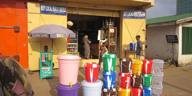 Aug. 4, 2014: According to local reports the sale of water buckets has increased dramatically, because they are used by Liberian people to fill with disinfectant and to wash their hands to prevent the spread of the deadly Ebola virus, in the city of Monrovia, Liberia. Dozens of local doctors and medical staff are among the dead, as foreign aid workers are arriving to help fight the Ebola outbreak and the Liberian government Information Minister Lewis Brown announced that all Ebola victims are to be cremated as fears rise that the disease could spread with bodies being buried in residential areas. (AP/Jonathan Paye-Layleh)