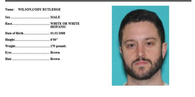 A wanted poster for Cody Wilson.