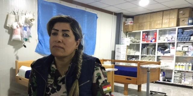 Nurse Khansa Ali in her clinic before Turkey destroyed it.