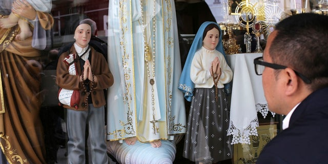 The statuettes of brother and sister Francisco and Jacinta, whom Pope Francis will canonize, is displayed in Fatima, Portugal, on May 12, 2017.