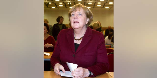 German Chancellor Angela Merkel attends a local meeting of her Christian Democrats, CDU, in Grimmen, northern Germany, Saturday, Jan. 28, 2017. Merkel said there's no solution yet to the problem of how to fairly share the burden of migration among European Union member states. (Stefan Sauer/dpa via AP)