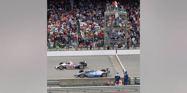 Al Unser Jr., top, edged out Scott Goodyear to win his first Indianapolis 500 in 1992. (AP Photo/David Boe, File)