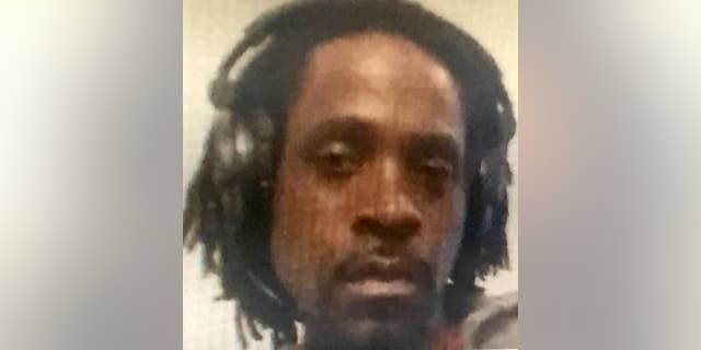This undated photo provided by the Fresno Police Department shows Kori Ali Muhammad, 39, who was arrested shortly after a shooting rampage outside a Catholic Charities building, in Fresno, Calif, on Tuesday, April 18, 2017.