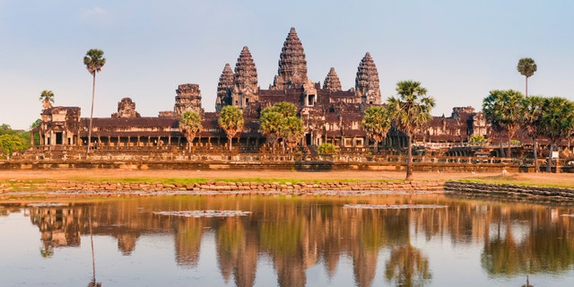 """""""A panoramic view of the spectacular ruins of the Angkor Wat temple complex in Cambodia.  Taken in golden evening light just before sunset, the scene is reflected in the large lotus pond in front.See several more from Angkor Cambodia, plus Vietnam and Laos:"""""""