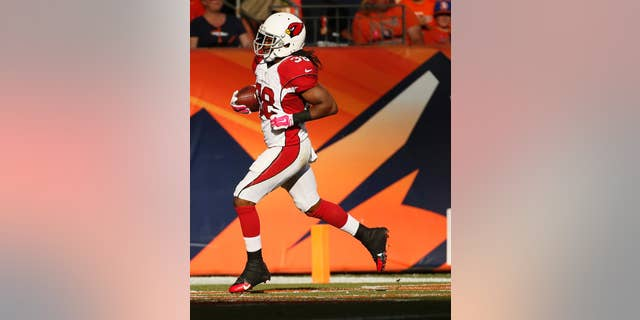 Arizona Cardinals running back Andre Ellington (38) scores a touchdown against the Denver Broncos during the second half of an NFL football game, Sunday, Oct. 5, 2014, in Denver. (AP Photo/Jack Dempsey)