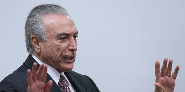 Brazil's acting President Michel Temer arrives to attend a meeting of ministers and military commanders on the preparations for the Rio 2016 Olympic Games, at the Planalto Presidential Palace, in Brasilia, Brazil, Monday, May 16, 2016. Temer assumed the presidency last week after President Dilma Rousseff was impeached and suspended for allegedly employing accounting tricks to hide gaping deficits in the federal budget. (AP Photo/Eraldo Peres)