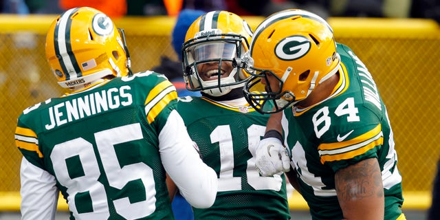 Green Bay Packers' Randall Cobb (18) celebrates with Greg Jennings and D.J. Williams after Cobb caught a touchdown pass during the first half of an NFL football game Sunday, Dec. 23, 2012, in Green Bay, Wis. (AP Photo/Mike Roemer)