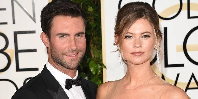 Adam Levine and Behati Prinsloo were married in 2014. They have two daughters, Dusty Rose, 2, and Gio Grace, 1.
