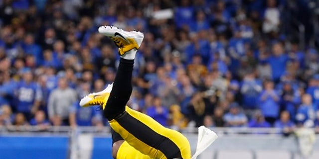 Pittsburgh Steelers wide receiver Antonio Brown (84) is flipped after making a catch against the Detroit Lions during an NFL football game in Detroit, Sunday, Oct. 29, 2017. Pittsburgh won 20-15. (AP Photo/Paul Sancya)