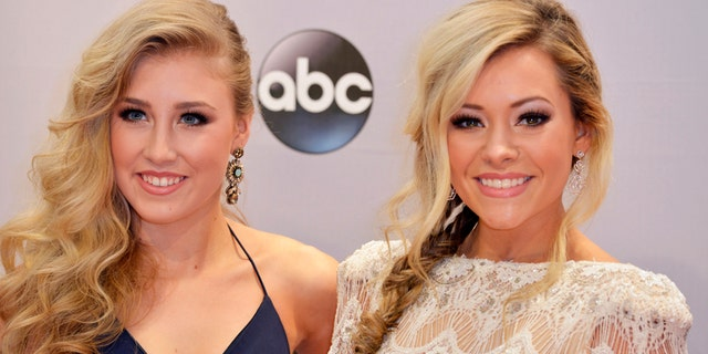 Maddie Marlow (L) and Tae Dye of the duo Maddie and Tae arrive at the 48th Country Music Association Awards in Nashville, Tennessee November 5, 2014.