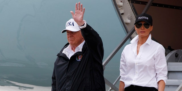 President Donald Trump, accompanied by first lady Melania Trump, waves as they arrive on Air Force One at Corpus Christi International Airport in Corpus Christi, Texas, Tuesday, Aug. 29, 2017, for briefings on Hurricane Harvey relief efforts. (AP Photo/Evan Vucci)