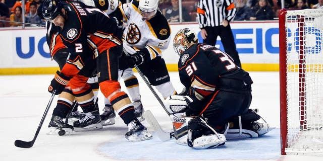Anaheim Ducks defenseman Eric Brewer, left, grabs the rebound after a stop by Ducks' goalie Frederik Andersen during the third period of an NHL hockey game Monday, Dec. 1, 2014, in Anaheim, Calif. (AP Photo/Lenny Ignelzi)