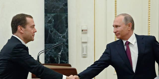 Russian President Vladimir Putin, right, shaking hands with Prime Minister Dmitry Medvedev last September.